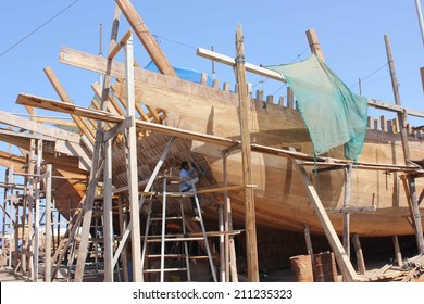 Sur, Oman, October 23, 2013: Man at work building a boat. Boat in Oman are built manually using wood