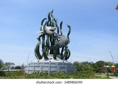 Surabaya east java, Indonesia, 24 August 2019: Patung suro and boyo  statue, a city symbol historical tale located in Taman Suroboyo isolated blue sky white clouds. Big new build near kenjeran beach