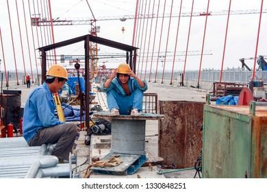 Surabaya, East java / Indonesia - May 10 2008 : Workers from China at the construction of the suramadu bridge
