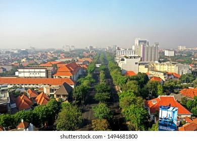 surabaya, east java - september 1st, 2019.  car free day on raya darmo street, surabaya.  aerial view of surabaya city