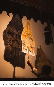 Surabaya, Indonesia, 08 02 2019 : The puppeteer (dalang) in Indonesia Wayang performance, Wayang kulit is traditional performance art of java