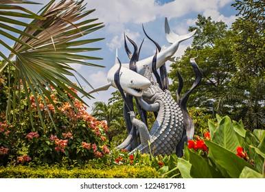 "Surabaya, Indonesia (11/04/2018) : Surabaya monument, famous landmark of the city, the Monument showed ""the shark and the crocodile fight"" as the symbol of Surabaya."