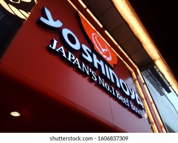 Surabaya, Indonesia - 31/12/2019 :   View of Yoshinoya japanese food rice bowl brand logo foodstore inside shopping mall