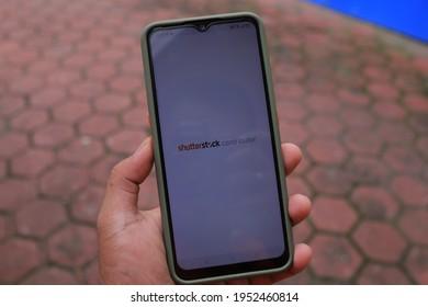 Surabaya, Indonesia - April 09, 2021: smartphone with shutterstock contributor aplication