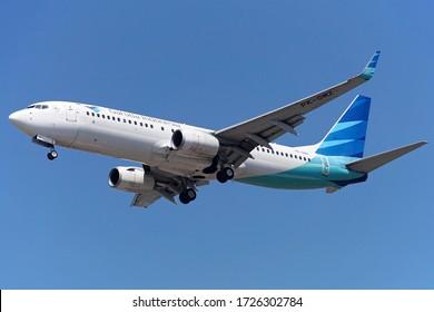 SURABAYA, INDONESIA - AUGUST 6, 2019: Garuda Indonesia Boeing 737-800 Arriving at Juanda International Airport.