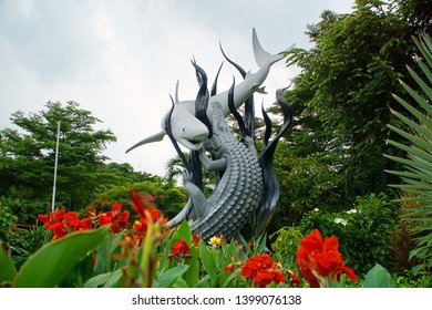 surabaya, Indonesia - ca 2019: The statue of Sura and Baya is a statue that is a symbol of the city of Surabaya. This statue is in front of the Surabaya Zoo.