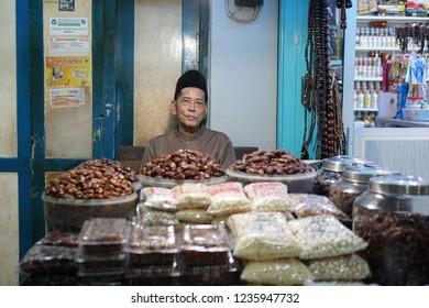 Surabaya, Indonesia - January 2018 : Local seller at traditional market selling dates
