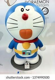 Surabaya, Indonesia - January 26th 2016: Doraemon Secret Gadgets Expo Event show doraemon doramee, nobita, model figurine and situation like the comic anime manga such as at house, background history