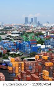 Surabaya, Indonesia - July 2, 2018: View of container terminal at  the port of Surabaya Petikemas Terminal (TPS), Tanjung Perak, Surabaya, East Java, Indonesia