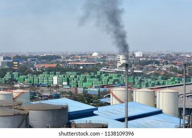 Surabaya, Indonesia - July 2, 2018: View of container terminal at  the port of Surabaya Petikemas Terminal (TPS), Tanjung Perak, Surabaya, East Java, Indonesia
