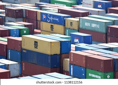Surabaya, Indonesia - July 2, 2018: Cargo container stacks at container terminal at port of Surabaya Container Terminal (TPS), Tanjung Perak, Surabaya, East Java, Indonesia