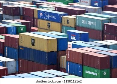 Surabaya, Indonesia - July 2, 2018: Cargo container stacks at container terminal at port of Surabaya Container Terminal (TPS), Tanjung Perak, Surabaya, East Java, Indonesia