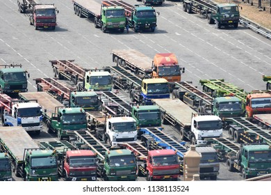 Surabaya, Indonesia - July 2, 2018: Parking trucks waiting to transport containers in Surabaya Container Terminal (TPS), Tanjung Perak, Surabaya, East Java, Indonesia