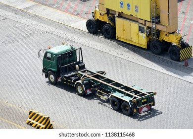 Surabaya, Indonesia - July 2, 2018: Truck passes to go to loading and unloading the container at port of Surabaya Petikemas Terminal (TPS), Tanjung Perak, Surabaya, East Java, Indonesia