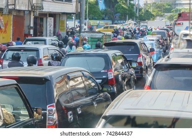 Surabaya Indonesia - Jun 11, 2016 : Traffic in Surabaya Indonesia pictured on Jun 11, 2016. Major town in Indonesia facing heavy traffic flow and the congestion is known in local as  Macet .