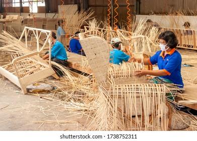 Surabaya / Indonesia - June 19, 2008: Process of weaving rattan in a furniture factory