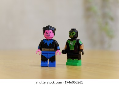 Surabaya, Indonesia - March 15, 2021: sinestro have more happy face than simon baz green lantern. lego minifigs are made by the lego group.