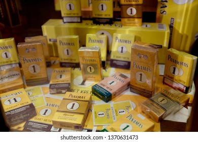 Surabaya, Indonesia - March 26, 2019: packs of Panamas cigarettes displayed in a cupboard in House of Sampoerna. The cigarette factory's history dates back to Dutch Colonial era. SMOKING KILLS