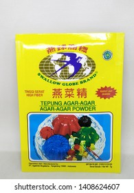 Surabaya, Indonesia - May 26th 2019: Famous Indonesian brand. Good for health. Agar agar walet double swallow sun jelly gelatin, delicious snack tasty, halal ingredient isolated on white background