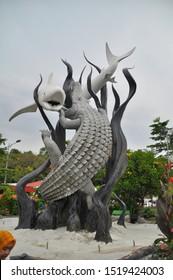 "Surabaya, Indonesia - November 15, 2015 : Surabaya monument, famous landmark of the city, the Monument showed ""the shark and the crocodile fight"" as the symbol of Surabaya."