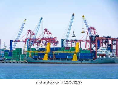 Surabaya, Indonesia - September 29, 2018: Container terminal at the port of Surabaya Petikemas Terminal (TPS), Tanjung Perak, Surabaya