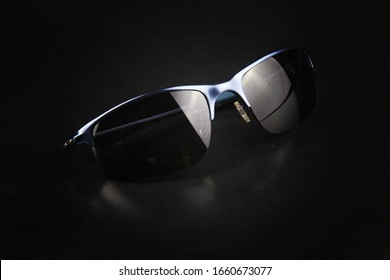 surabaya-indonesia. February 25, 2020. Stylish men's oakley sunglasses with black background. Oakley design provides comfort for its users
