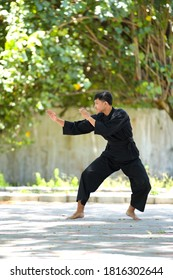 Surakarta City, Central Java, Indonesia, September 16, 2020; A young man is practicing Pencak Silat, a traditional martial art from Indonesia. Demonstrate a few movements.