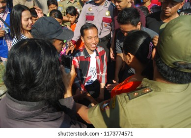 Surakarta, Jawa Tengah, Indonesia - September 23, 2012 : Surakarta residents surrond Joko Widodo (Jokowi) as governor candidate in Car Free Day.