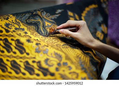 SURAKARTA JUNE 17 2019 : Closeup Hand Painting Batik on the Fabric. Batik Tulis in Solo Indonesia