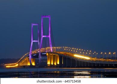 The Suramadu Bridge at Twilight with colorful lighting in Surabaya,Indonesia.Is the longest Bridge in Indonesia.