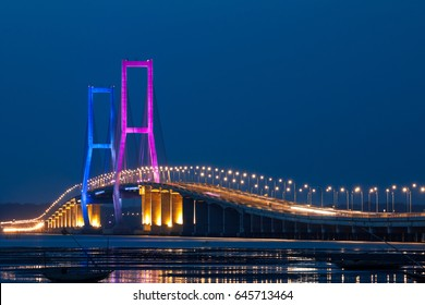 The Suramadu Bridge at Twilight with colorful lighting in Surabaya,Indonesia.Is the longest Bridge in Indonesia.