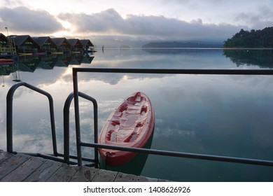 Surat thani ,Thailand - 30 June 2018 : This is morning view from the houseboat at the lake of Chaio lan dam. It located in south of Thailand. There is canoe in front of the houseboat.