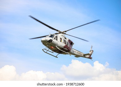 Surat Thani, THAILAND - December 9, 2020: Bell 412EPI No. 2612 form Thai Police Aviation Division, Landing between Deputy Minister of Agriculture and Cooperatives inspection program.