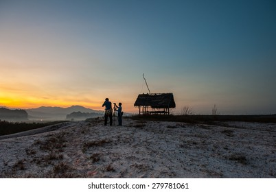 SURAT THANI THAILAND- Feb. 4:Tourists and photographers take a sunset photo at the viewer point. Feb. 4, 2015 in Surat thani province,Thailand
