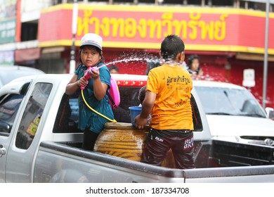 SURATTHANI, THAILAND - APRIL 13 : Songkran Festival is celebrated in Thailand as the traditional New Year's Day from 13 to 15 April by throwing water at each other, on 13 April 2014 in Suratthani.