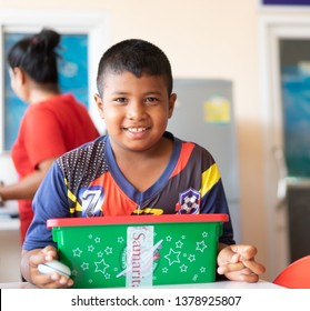 SURATTHANI, THAILAND - December 25, 2018 : Little thai boy very happy when he have received gift box from Samaritan's purse at Church in Christmas time.