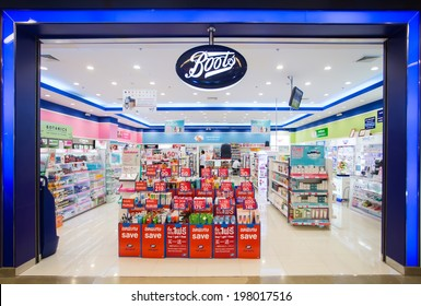 SURATTHANI, THAILAND - JUNE 11: Exterior view of Boots pharmacy store on June 11, 2014 in Suratthani, Thailand. The Boots pharmacy chain has over 3,300 stores in 21 countries.