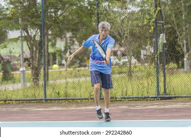 SURATTHANI, THAILAND - JUNE 20: Unidentifiled Thai tennis player in action during play tennis at Lang Suan tennis court on June 20, 2015 in Suratthani, Thailand.