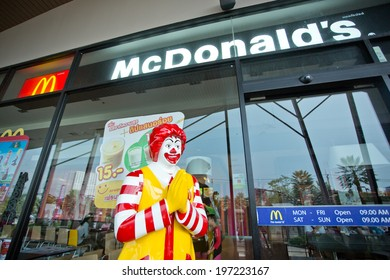 SURATTHANI, THAILAND - JUNE 7: Exterior view and mascot of a McDonald's Restaurant on June 7, 2014 in Suratthani, Thailand. It is the world's largest chain of hamburger fast food restaurants.