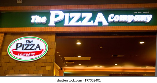 SURATTHANI, THAILAND - JUNE 7: The Pizza Company Restaurant Sign on June 7, 2014 in Suratthani, Thailand. It is a restaurant chain and international franchise based in Bangkok, Thailand.