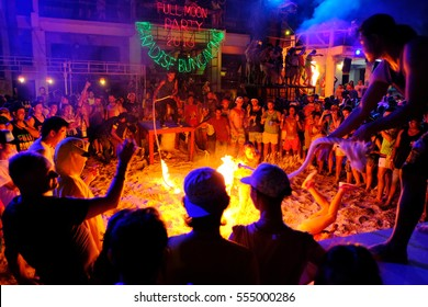 Suratthani , Thailand - May 21, 2016 : the audience participate the flaming skipping rope show at full moon party, Koh - Phangan,Thailand