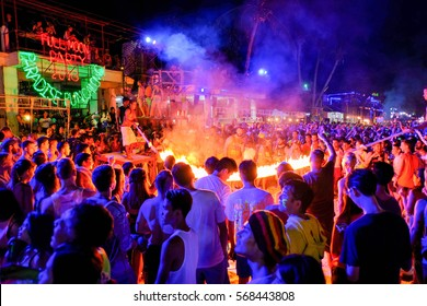 Suratthani, Thailand - May 21 , 2016 : the audience participate the flaming skipping rope show at Full moon party, Phangan island ,Thailand