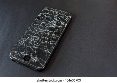 SURATTHANI , THAILAND - SEPTEMBER 18, 2016: Shot of an iPhone5 with broken protector film retina display screen. iPhone 5 is a smartphone developed by Apple Inc.