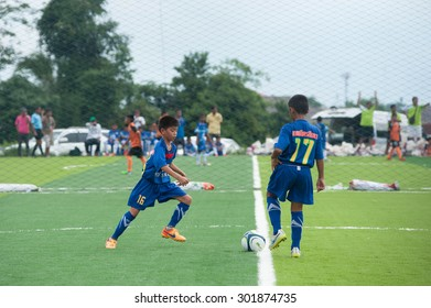 Suratthani,Thailand, July 31,2015: Youth football on artificial turf to encourage children to exercise and time to be usefu