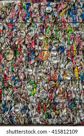 Suratthani,Thailand, May 5,2016:Aluminium cans pressed and plastic bottle to packed for recycling .