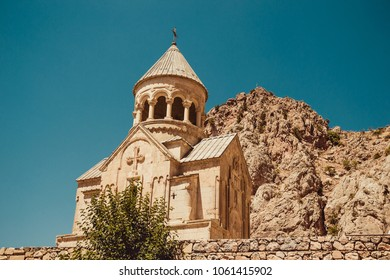 Surb Astvatsatsin Church, Noravank. Armenian culture. Architecture concept. Pilgrimage place. Religion background. Travel to Armenia. Tourism industry. Tourist landmark. Bright sunny day. Cliff view
