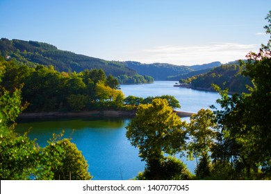 Sure river in Lultzhausen, Esch-sur-Sure, Luxembourg. Beautiful landscape with green mountains at the both sides
