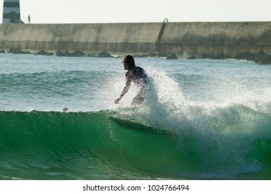 Surf action at Molhe do Este Supertubos beach in Peniche, Estremadura, Portugal.