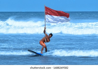 SURF ACTIVITIES BY YOUTH IN CELEBRATING INDEPENDENCE OF INDONESIA IN BRAWA BEACH, BALI, INDONESIA ON AUGUST 17, 2017