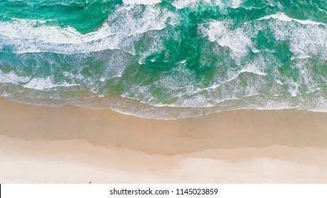 Surf Beach Aerial On Drone Top View With Ocean Waves Reaching Shore